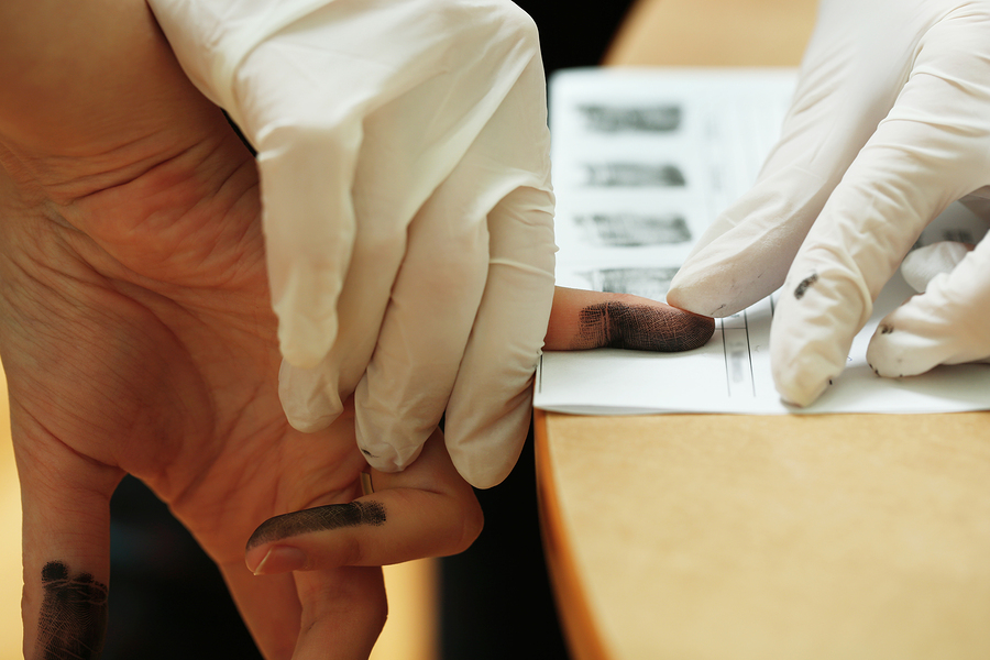 bigstock_Taking_fingerprints_90274682.jpg